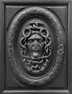 Detail of a Medusa on the door of the Hôtel Amelot de Bisseuil.